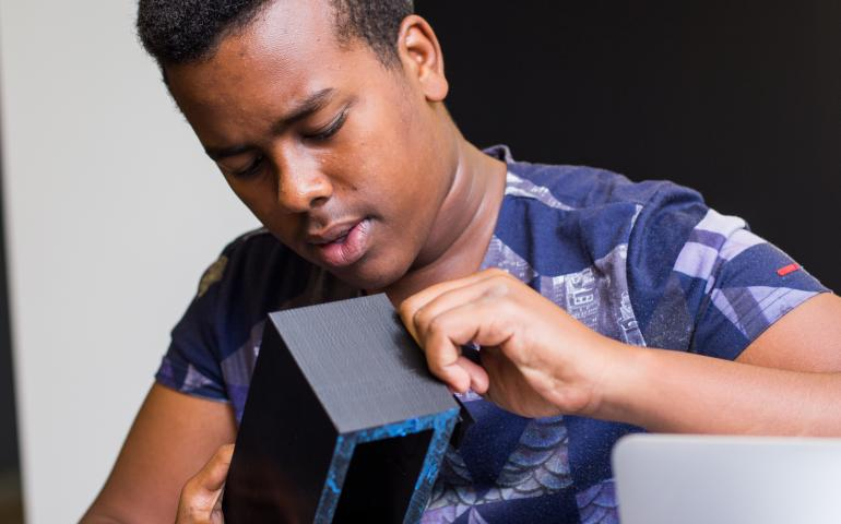 a student working with 3d printed materials